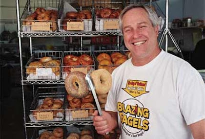 Blazing Bagel Owner Holding Bagle