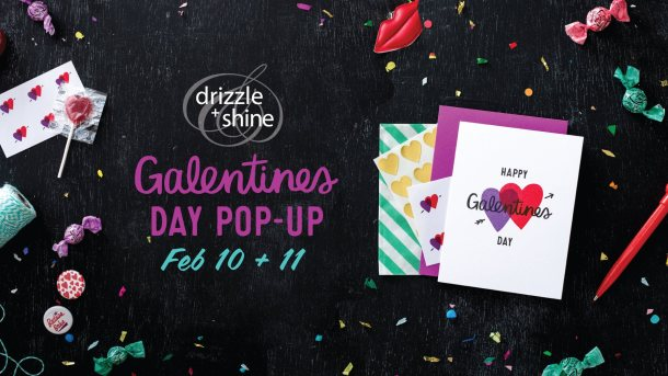 "Cards with hearts on a black background with text that says ""Galentine's Day Pop-up Feb 10 + 11, Drizzle and Shine"""