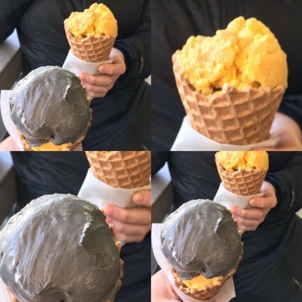 Gray ice cream with bright orange ice cream in waffle cones